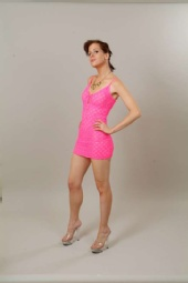 Alys McDonough - Alys with pink dress looking coy